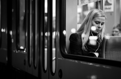 young-women-in-the-window-of-the-bus-at-night-black-and-white-photo