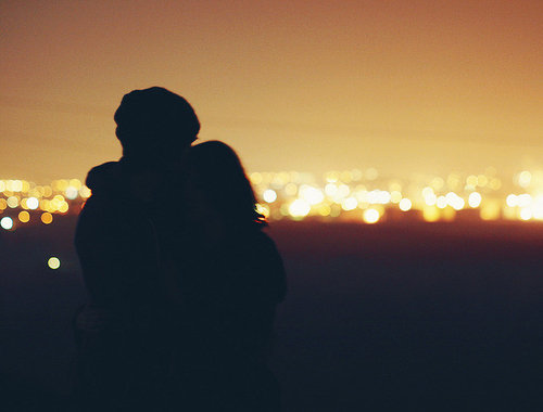 couple overlooking lights