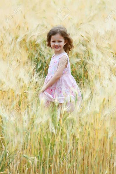 13253078-a-little-girl-sing-and-dance-in-a-field-of-rye